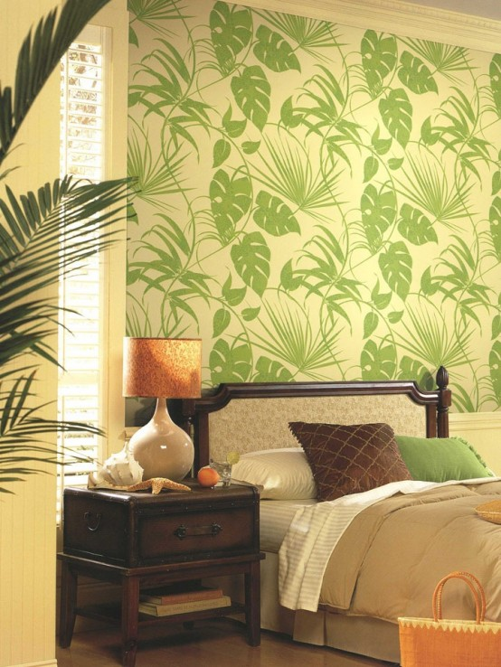 a tropical print statement wall, dark stained wooden furniture, potted palm trees and touches of rust
