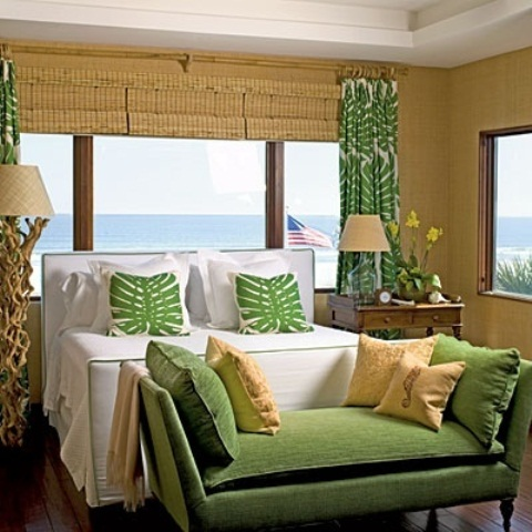 wicker shades, tropical print textiles, a driftwood base lamp and an antique wooden nightstand