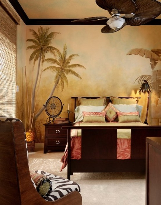 a palm wall mural, dark stained furniture and animal print textiles make the space feel like a tropical one