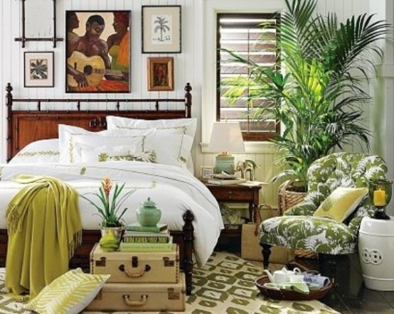 a gallery wall with tropical-inspired artworks, a potted palm, a tropical print chair and touches of green and pistachio