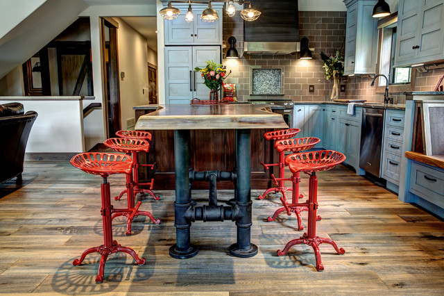 brutal kitchen island pipe legs and cute red chairs are definitely a focal point of this kitchen