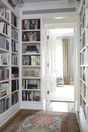 a corridor with built-in bookshelves on both sides is a stylish idea that will save much space and store all your books