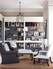 a neutral living room with built-in bookshelves on two walls by the fireplace is a very stylish and cool idea