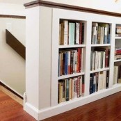 bookshelves built into railings are a nice way to accent the staircase and store some books