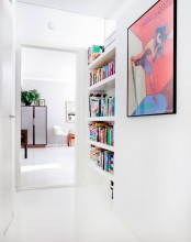 a little awkward nook with built-in shelves is a stylish and smart way to store your books and save soem space