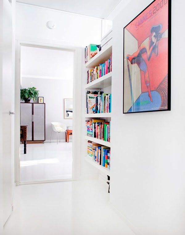 a little awkward nook with built in shelves is a stylish and smart way to store your books and save soem space