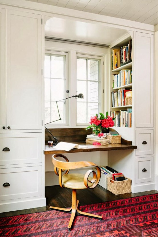 a storage unit with built-in shelves on both sides and a built-in desk is a very compact piece that can be placed in a small home office or just as a working nook