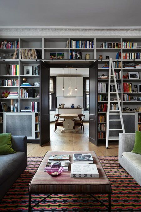 a whole wall taken by built-in shelves will turn your living room or any other room into a library