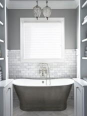 a cute small bathroom design in shades of gray