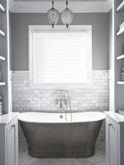 a cute small bathroom design in shades of gray