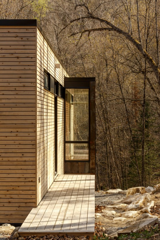 Cantilivered Lake Cottage With Airy White Oak Interiors