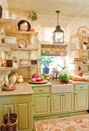 a vintage pastel kitchen with green cabinets, open shelves instead of upper cabinets, a black lamp and a pritned rug