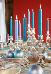 silver candleholders and pinecones, blue candles and blue and silver ornaments will make your Christmas tablescape feel and look frozen