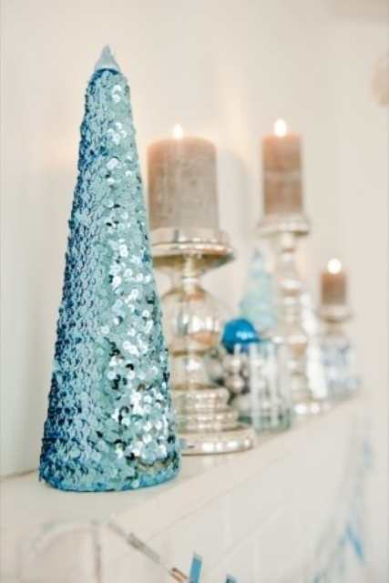 a tiffany blue sequin Christmas tree on the mantel is a cool and sweet decoration to rock