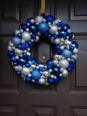 a bright Christmas wreath of ornaments – blue, electric blue and silver ones is a bright and cool idea for a frozen feel