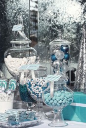 a Christmas candy buffet with white, blue and bold blue candies, chocolate and other tasty things is amazing