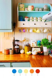 a colorful kitchen with blue cabinets, wooden countertops and bold mugs and plates for a funny touch