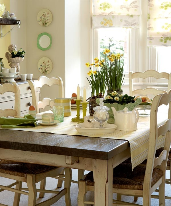 a neutral kitchen with a dining zone and touches of green and yellow here and there to make the space brighter and cooler