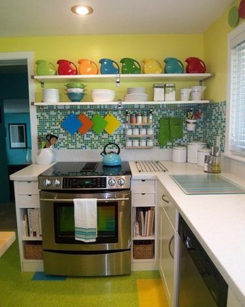 a colorful kitchen with a neon green floor, a green tile backsplash, a yellow wall and open shelves and bright tableware