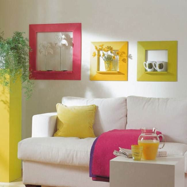 bold textiles, a sunny yellow plant stand and colorful frames enliven the living room making it feel summer like
