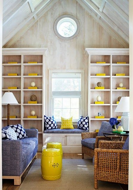 sunny yellow accessories and pillows plus a side table make the space look super bold and bright