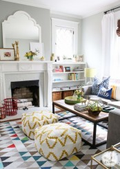 a bright printed rug, bold blooms, red baskets for firewood and some other colorful details make the space extra bold and summer-like