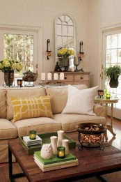 potted blooms, greenery, touches of yellow and green bring a cheerful summer feel to the living room