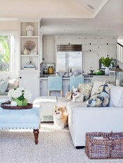 floral print pillows, blue furniture and potted blooms bring a fresh summer feel to the space