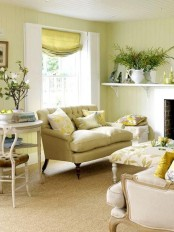 floral print textiles, greenery and blooms in vases for a fresh summer feel in the neutral living room