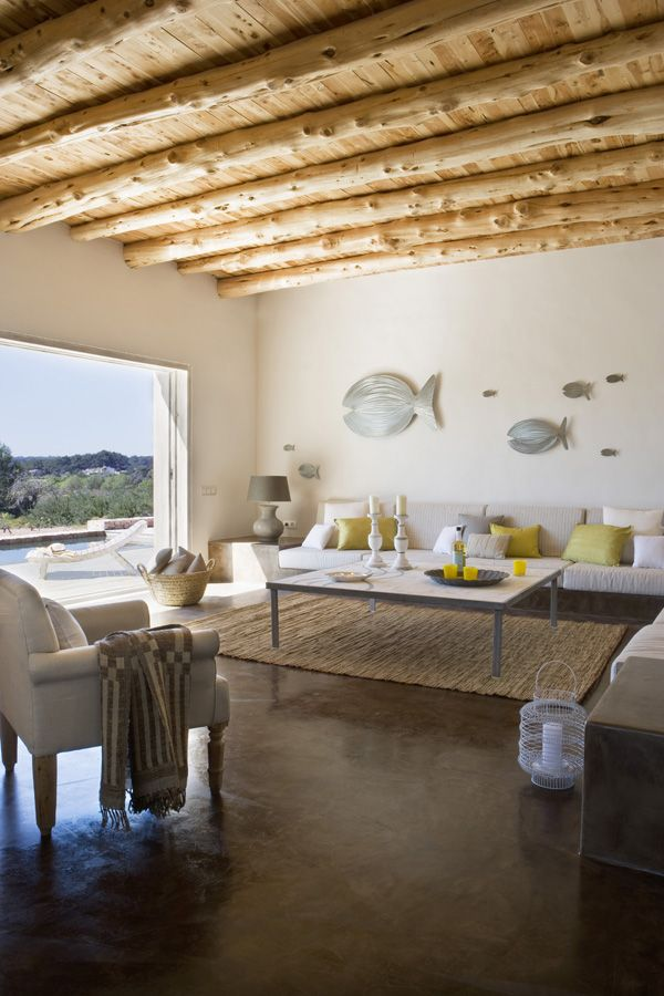 bold pillows and a gorgeous outdoor opening for bringing a summer feel to the living room