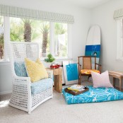 bright pillows, ottomans, cushions, artworks and greenery for a tropical feel in the living room