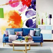 a super bright floral artwork and matching bright pillows for a bold summer feel in the living room