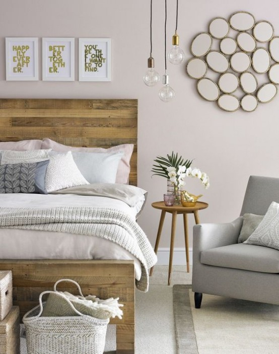 a welcoming mid-century modern bedroom with a pallet wood bed, cozy furniture, artworks and hanging bulbs
