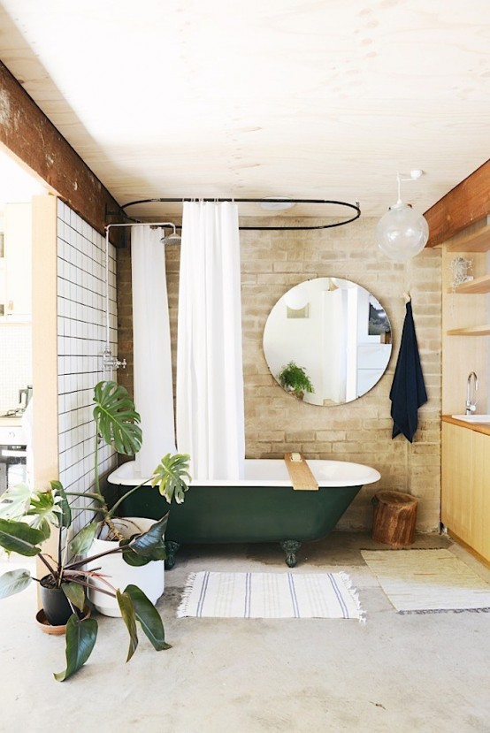 Chic Brick Bathroom Design With A Retro Green Bathtub