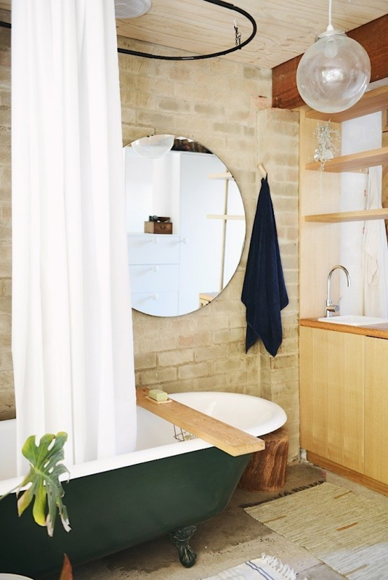 Chic Brick Bathroom With A Retro Green Bathtub
