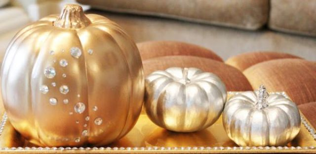 gold and silver pumpkins decorated with crystals are bright and romantic Halloween decorations or centerpieces