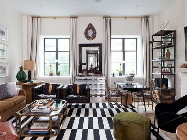 chic glam living room with black and white rug