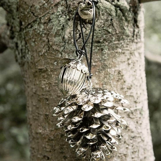 a mercury glass pinecone and an acorn can be used as fall or winter decorations for your home