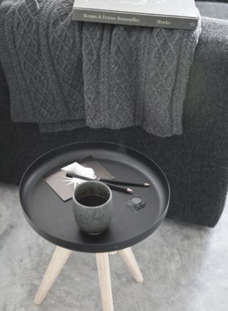 a grey knit blanket, a matte black and wood side table plus matching tableware for the fall and winter