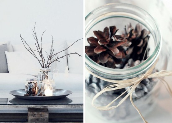 a Nordic fall centerpiece of a tray, pinecones in a jar, branches, candles is a simple and natural idea