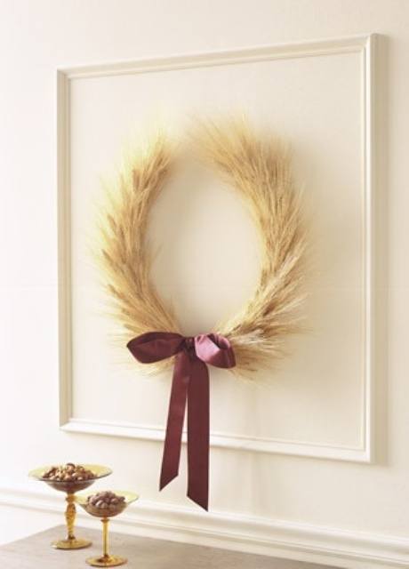 an artwork of a wheat wreath accented with a purple bow is a cool idea for natural and rustic fall decor