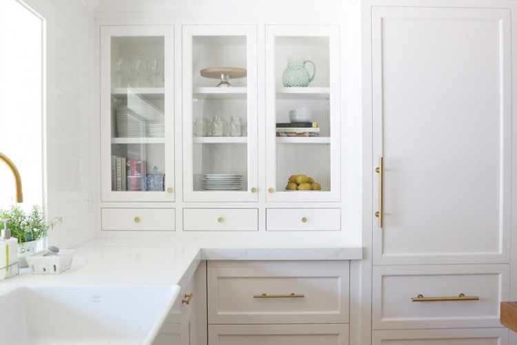 Chic White Kitchen Remodel With Brass Touches
