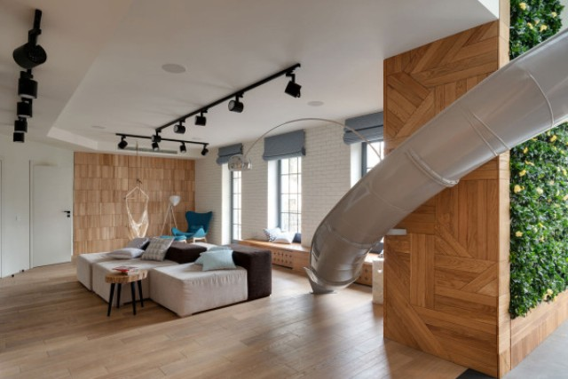 Picture Of childhood fantasies come true modern apartment with a slide  6