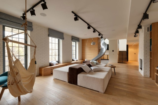 Picture Of childhood fantasies come true modern apartment with a slide  8