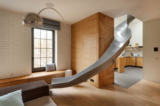 Picture Of childhood fantasies come true modern apartment with a slide  9