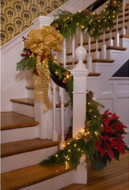 Don't forget to add some lights to evergreen garlands on your staircase. Just make sure they are small and invisible.