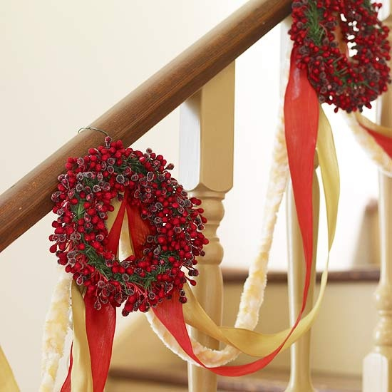 Put wreaths on display beyond the front door. For example, on a stairway.