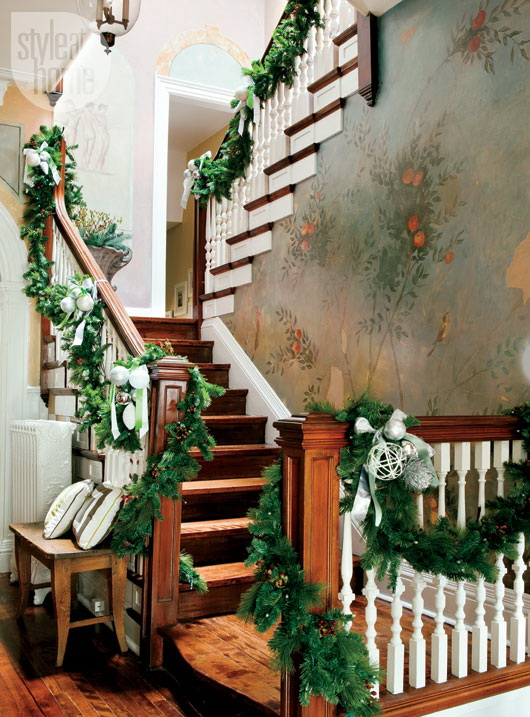 Loosely swagged pine ropings could be used on any staircase. Don't forget to add some details to them starting with ornaments.