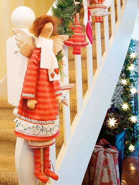 Evergreen swags with red accents looks wonderful on any white staircase.
