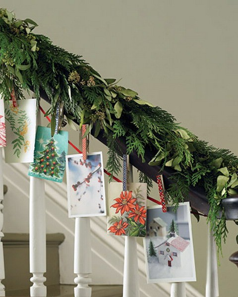 To dress your staircase for the holiday season, upgrade a garland of evergreen with beautiful seasonal pictures.